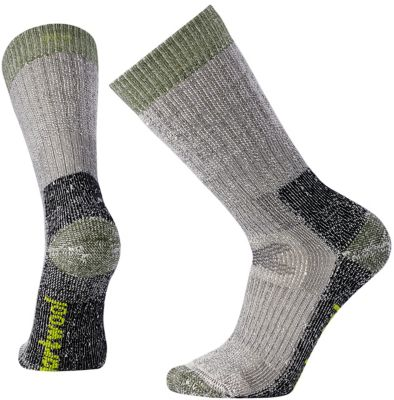 Socks are sacred because your feet are critical to every important mission. Our Hunt Extra Heavy Crew is hunt-ready from dawn to dusk. And beyond, if that's where you're going. They're taller than most crews, so they fit in taller boots, like yours. The Smartwool® fit system helps keep the socks in place while you're on the move. Heavy cushioning and Merino breathability.