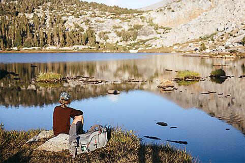 Person enjoying view of lake