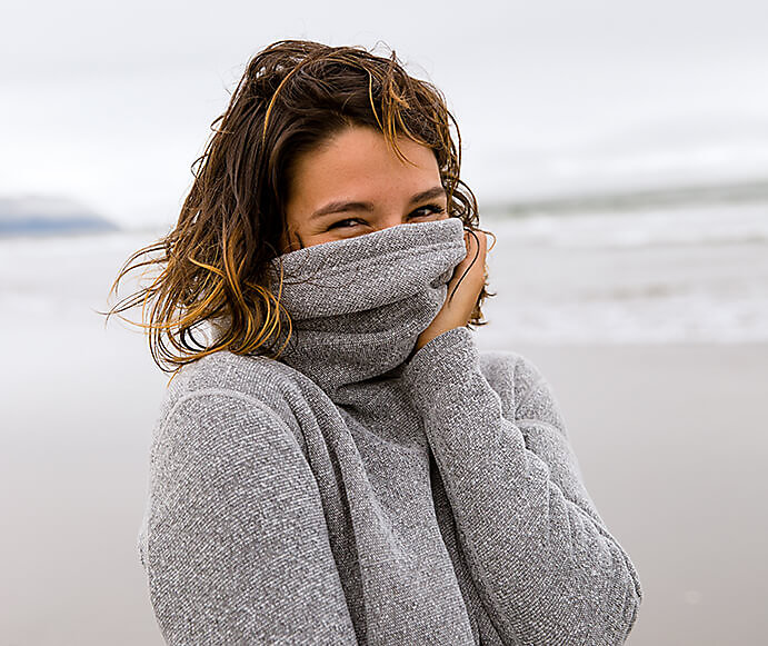 Smartwool model wearing sweater made with sustainable wool
